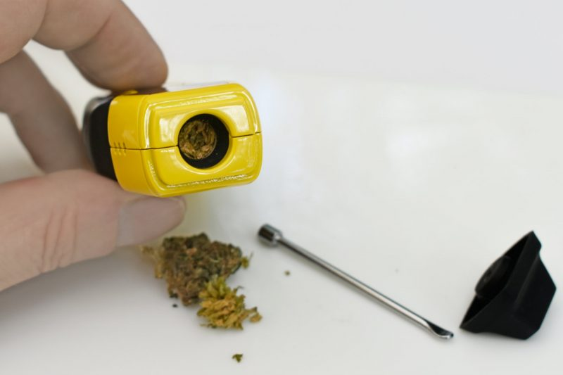 Packing ground weed into vaporizer heating chamber